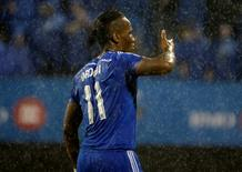 Montreal Impact forward Didier Drogba (11) reacts after scoring a goal on a free kick during the second half against the New England Revolution at Stade Saputo. Eric Bolte-USA TODAY Sports