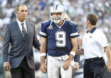 Sep 20, 2015; Philadelphia, PA, USA; Dallas Cowboys quarterback Tony Romo (9) is helped off the field after being sacked against the Philadelphia Eagles during the third quarter at Lincoln Financial Field. Eric Hartline-USA TODAY Sports