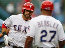Texas Rangers first baseman Mitch Moreland (L) celebrates his home run with third base coach Tony Beasley (27) against the Seattle Mariners during the second inning at Globe Life Park in Arlington. Sep 20, 2015; Arlington, TX, USA.  Jim Cowsert-USA TODAY Sports