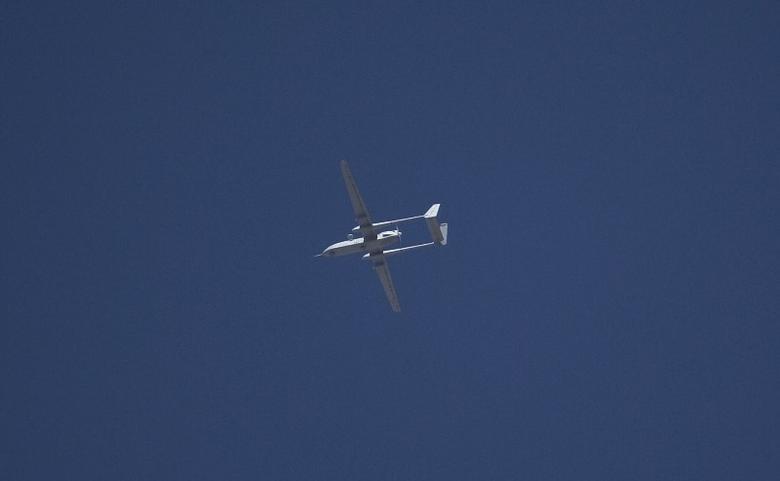An Israeli drone flies over the West Bank city of Hebron in this June 14, 2014 file photo. REUTERS/Ronen Zvulun/Files