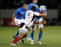 Phil Thiel (L) of the U.S. tackles Italy's Cornelius van Zyl during their Rugby World Cup Pool C match at Trafalgar Park in Nelson September 27, 2011. REUTERS/Brandon Malone