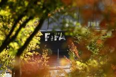FIFA's logo is seen in front of its headquarters during a meeting of the FIFA executive committee in Zurich, Switzerland, September 25, 2015. REUTERS/Arnd Wiegmann