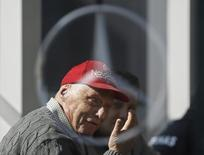 Former Formula One driver Niki Lauda of Germany is pictured speaking though a Mercedes logo during testing session at the Catalunya racetrack in Montmelo, near Barcelona February 20, 2015.  REUTERS/Albert Gea