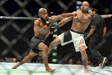 Sep 5, 2015; Las Vegas, NV, USA; Demetrious Johnson (red gloves) and John Dodson (blue gloves) during their flyweight title bout at UFC 191 at MGM Grand Garden Arena. Johnson won the fight. Mandatory Credit: Jayne Kamin-Oncea-USA TODAY