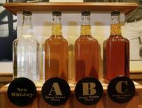 Bottles showing the barrel aging process are seen at the Jack Daniel's distillery in Lynchburg, Tennessee May 10, 2011.  REUTERS/ Martinne Geller