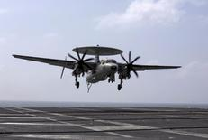 A U.S. Navy Northrop Grumman E-2 Hawkeye prepares to land  in the South China Sea November 7, 2013. REUTERS/Tyrone Siu