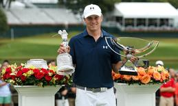 Sep 27, 2015; Atlanta, GA, USA; Jordan Spieth with the tournament trophy and FedEx Cup trophy after winning the final round of the Tour Championship by Coca-Cola at East Lake Golf Club. Mandatory Credit: Jason Getz-USA TODAY Sports