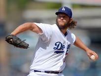 Oct 4, 2015; Los Angeles, CA, USA; Los Angeles Dodgers starting pitcher Clayton Kershaw (22) in the first inning of the game against the San Diego Padres at Dodger Stadium. Mandatory Credit: Jayne Kamin-Oncea-USA TODAY Sports