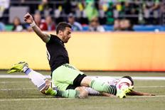 Oct 4, 2015; Seattle, WA, USA; Seattle Sounders FC defender Zach Scott (20) clears a ball against the Los Angeles Galaxy during the first half at CenturyLink Field. Los Angeles tied Seattle, 1-1.  Joe Nicholson-USA TODAY Sports
