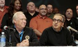 Fiat Chrysler Automobiles (FCA) CEO Sergio Marchionne (R) and United Auto Workers (UAW) union President Dennis Williams announce a tentative agreement during a news conference in Detroit, Michigan, September 15, 2015. REUTERS/Rebecca Cook