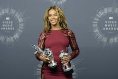 Beyonce poses backstage with three of her four awards during the 2014 MTV Video Music Awards in Inglewood, California August 24, 2014.  REUTERS/Kevork Djansezian