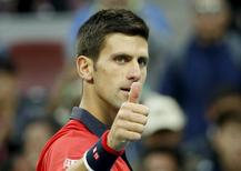 Novak Djokovic of Serbia reacts after winning against Zhang Ze of China during a men's singles match  at the China Open tennis tournament in Beijing, China, October 8, 2015.    REUTERS/Kim Kyung-Hoon