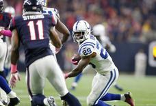 Oct 8, 2015; Houston, TX, USA; Indianapolis Colts cornerback safety Mike Adams (29) returns his fourth quarter touchdown against Houston Texans receiver Jaelen Strong (11) at NRG Stadium.  Matthew Emmons-USA TODAY Sports