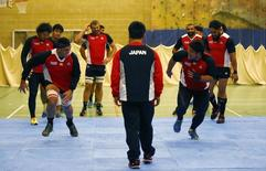Rugby Union - Japan Training - Warwick School - 7/10/15 Japan's Hendrik Tui (L) races Kensuke Hatakeyama during training Action Images via Reuters / Darren Staples Livepic - RTS3G6A