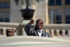 "Nation of Islam leader Louis Farrakhan speaks from behind a layer of glass on the steps of the U.S. Capitol at a rally billed as ""Justice or Else"" to mark the 20th anniversary of the Million Man March on the National Mall in Washington October 10, 2015. REUTERS/James Lawler Duggan"