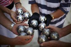 British migrants show petanque balls as they play boules at The British Society in Benalmadena, near Malaga, southern Spain, September 30, 2015. REUTERS/Jon Nazca