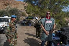 British actor Daniel Craig (R), a UN advocate against use of landmines and explosives, gets a  briefing from Cambodian de-miners at an active minefield in Cyprus, October 12 2015. REUTERS/UN/Handout