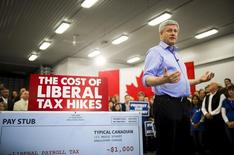 Canada's Prime Minister and Conservative leader Stephen Harper speaks at a campaign event at the Martin Family Fruit Farm in Waterloo, October 12, 2015.    REUTERS/Mark Blinch