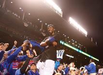 Oct 13, 2015; Chicago, IL, USA; Chicago Cubs center fielder Dexter Fowler (24) celebrates with the crowd after defeating the St. Louis Cardinals in game four of the NLDS at Wrigley Field. Mandatory Credit: Caylor Arnold-USA TODAY Sports