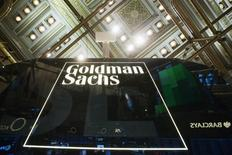 A Goldman Sachs sign is seen above the floor of the New York Stock Exchange shortly after the opening bell in the Manhattan borough of New York January 24, 2014.  REUTERS/Lucas Jackson (UNITED STATES - Tags: BUSINESS) - RTX17T1D