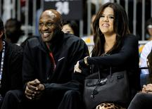 Los Angeles Lakers' Lamar Odom and his wife television personality Khloe Kardashian sit courtside as they attend the 2011 BBVA All-Star Celebrity basketball game as a part of the NBA All-Star basketball weekend in Los Angeles, in this February 18, 2011, file photo. REUTERS/Danny Moloshok/Files