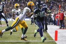 Sep 4, 2014; Seattle, WA, USA; Seattle Seahawks fullback Derrick Coleman (40) beats Green Bay Packers cornerback Tramon Williams (38) to the end zone for a 15-yard touchdown reception during the fourth quarter at CenturyLink Field. Mandatory Credit: Joe Nicholson-USA TODAY Sports