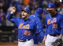 Oct 18, 2015; New York City, NY, USA; New York Mets second baseman Daniel Murphy (28) celebrates with teammates on the field after defeating the Chicago Cubs in game two of the NLCS at Citi Field. Mandatory Credit: Robert Deutsch-USA TODAY Sports
