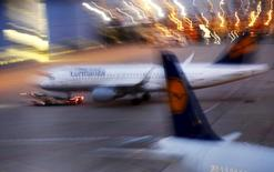 Passenger planes of German air carrier Lufthansa are parked in and outside a technical maintaining hall at the Frankfurt Airport in Germany, early morning September 9, 2015. REUTERS/Kai Pfaffenbach