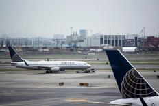 United Airlines planes are seen on platform at the Newark Liberty International Airport in New Jersey, July 8, 2015. United Airlines resumed flights at all U.S. airports on Wednesday after they were grounded due to computer issues, according to the Federal Aviation Administration. The FAA issued the order to prevent all United Airlines flights from taking off following a systemwide computer glitch, which was resolved, the agency said. REUTERS/Eduardo Munoz - RTX1JLOB