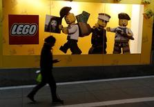 A woman walks past a window display of Lego at a Saga Falabella department store in the Miraflores district of Lima August 27, 2014. REUTERS/Mariana Bazo