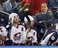 Oct 12, 2015; Buffalo, NY, USA; Columbus Blue Jackets head coach Todd Richards watches play from the bench during the first period against the Columbus Blue Jackets at First Niagara Center. Mandatory Credit: Kevin Hoffman-USA TODAY Sports