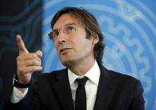 Pietro Beccari, Chief Executive Officer of Fendi maison, gestures during an interview during the inauguration of the new headquarters at the Palazzo della Civilta' Italiana in Rome October 22, 2015. REUTERS/Alessandro Bianchi