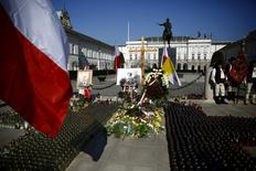 Candles and flowers are laid in front of the Presidential Palace during a ceremony, to mark the fifth anniversary of the crash of the Polish government plane in Smolensk, Russia, that killed 96 people on board including the late President Kaczynski and his wife Maria, in Warsaw, Poland April 10, 2015. REUTERS/Kacper Pempel