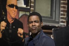 """Comedian Chris Rock arrives at the Ed Sullivan Theater in Manhattan to take part in the taping of tonight's final edition of """"The Late Show"""" with David Letterman in New York May 20, 2015.  REUTERS/Lucas Jackson"""