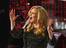 "British singer Adele performs the song ""Skyfall"" from the film ""Skyfall,"" nominated as best original song, at the 85th Academy Awards in Hollywood, California February 24, 2013.     REUTERS/Mario Anzuoni/Files"