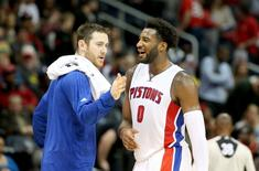 Oct 27, 2015; Atlanta, GA, USA; Detroit Pistons center Andre Drummond (0) celebrates a play with forward Aron Baynes in the fourth quarter of their game against the Atlanta Hawks at Philips Arena. Mandatory Credit: Jason Getz-USA TODAY Sports