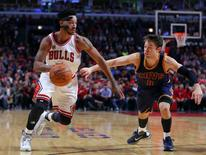 Chicago Bulls guard Derrick Rose (1) drives on Cleveland Cavaliers guard Matthew Dellavedova (8) during the second half at the United Center. Chicago won 97-95. Dennis Wierzbicki-USA TODAY Sports