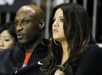 Los Angeles Lakers' Lamar Odom (L) and his wife television personality Khloe Kardashian sit courtside as they attend the 2011 BBVA All-Star Celebrity basketball game as a part of the NBA All-Star basketball weekend in Los Angeles, February 18, 2011. REUTERS/Danny Moloshok
