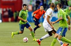 Oct 28, 2015; Seattle, WA, USA; Seattle Sounders FC forward Nelson Valdez (16) dribbles the ball against the Los Angeles Galaxy during the first half at CenturyLink Field. Seattle defeated Los Angeles 3-2. Mandatory Credit: Steven Bisig-USA TODAY Sports