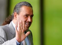 Kuwait's member of the FIFA executive committee Sheikh Ahmad Al-Fahad Al-Sabah of Kuwait waves as he takes a break during an extraordinary meeting of the FIFA Executive Committee in front of FIFA's headquarters in Zurich, Switzerland October 20, 2015.    REUTERS/Arnd Wiegmann