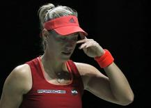 Tennis - BNP Paribas WTA Finals - Singapore Indoor Stadium, Singapore Sports Hub - 30/10/15 Germany's Angelique Kerber looks dejected during the round robin match Action Images via Reuters / Jeremy Lee