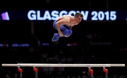 Britain's Max Whitlock competes on the parallel bars during the men's all-around final at the World Gymnastics Championships at the Hydro arena in Glasgow, Scotland, October 30, 2015. REUTERS/Russell Cheyne