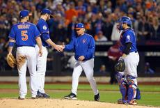 Nov 1, 2015; New York City, NY, USA; New York Mets starting pitcher Matt Harvey (second left) is relieved by manager Terry Collins in the 9th inning against the Kansas City Royals in game five of the World Series at Citi Field. Mandatory Credit: Brad Penner-USA TODAY Sports