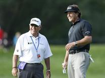 Phil Mickelson (R) of the U.S. walks to the third green with his swing coach Butch Harmon during a practice round for the 2013 PGA Championship golf tournament at Oak Hill Country Club in Rochester, New York August 6, 2013.  REUTERS/Mathieu Belanger