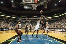 Nov 5, 2015; Minneapolis, MN, USA; Miami Heat guard Dwyane Wade (3) goes up for a layup past Minnesota Timberwolves guard Kevin Martin (23) in the second half at Target Center. The Heat won 96-84. Mandatory Credit: Jesse Johnson-USA TODAY Sports