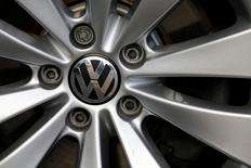 The VW logo is pictured on a wheel of a Volkswagen car at a car shop in Bad Honnef near Bonn, Germany, November 4, 2015.  REUTERS/Wolfgang Rattay