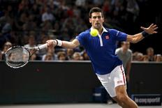 Novak Djokovic of Serbia returns the ball to Tomas Berdych of the Czech Republic in their men's singles quarter-final tennis match at the Paris Masters tennis tournament at the Bercy sports hall in Paris, France, November 6, 2015. REUTERS/Charles Platiau