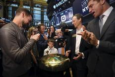 Jack Dorsey (L), CEO of Square and CEO of Twitter, Jim McKelvey co-founder of Square (2nd R) and NYSE President Tom Farley (R) watch as Mac Riley rings a ceremonial opening bell on the floor of the New York Stock Exchange for the IPO of Square Inc., in New York November 19, 2015. REUTERS/Lucas Jackson
