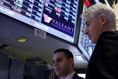 Activist investor Bill Ackman (R), chief executive of Pershing Square Capital, speaks with specialist trader Michael Cacace, at the post where Valeant Pharmaceuticals International Inc. is traded  on the floor of the New York Stock Exchange November 10, 2015. REUTERS/Brendan McDermid