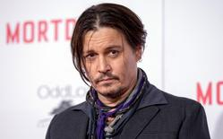 "Cast member Johnny Depp poses at the premiere of ""Mortdecai"" at the TCL Chinese theatre in Hollywood, January 21, 2015.    REUTERS/Mario Anzuoni"